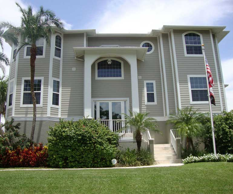 House with window tint in Naples, Florida performed by Suntamers Window Tinting