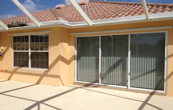 Home with tinted slider doors and window in Bonita Springs, Florida